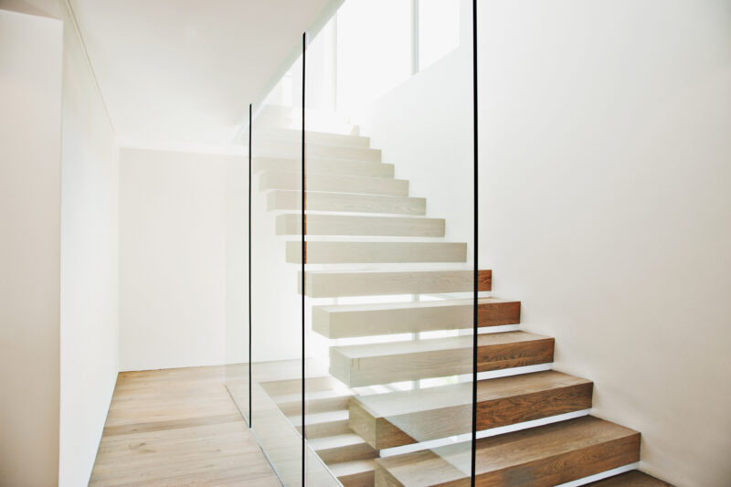 Floating staircase and glass walls balaustrades in modern house